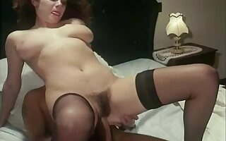 Busty hairy brunette suffers some serious dicking